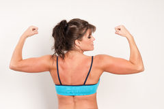 Mature female athlete flexing her muscles Stock Photo