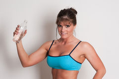 Mature female athlete with water bottle Stock Image