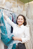 Mature female buyer. At clothing store Royalty Free Stock Photo