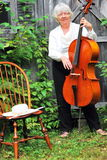 Mature female cellist. Stock Photos