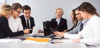 Mature female chief leads meeting royalty free stock photography
