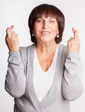Mature female with crossed fingers Royalty Free Stock Photo