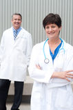 Mature female doctor with colleague Stock Photography