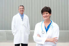 Mature female doctor with colleague Royalty Free Stock Photo
