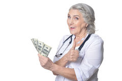 Mature female doctor with money Royalty Free Stock Photography