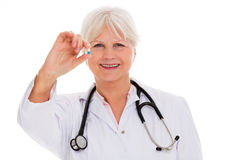 Mature female doctor smiling Royalty Free Stock Images