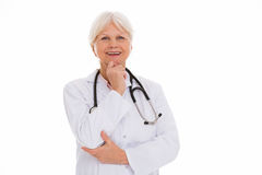 Mature female doctor smiling Royalty Free Stock Photography