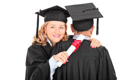 Mature female graduate hugging a man Stock Image