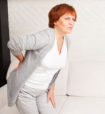 Mature female has pain in back Royalty Free Stock Images