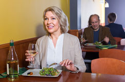 Mature female having lunch in restaurant Stock Photography
