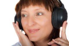 Mature female in headphones Stock Photo