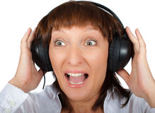 Mature female in headphones Royalty Free Stock Image