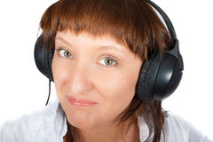 Mature female in headphones Royalty Free Stock Photography