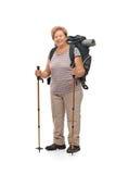 Mature female hiker posing with hiking equipment Stock Image