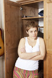 Mature female making choices in wardrobe Royalty Free Stock Images