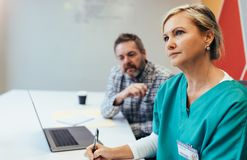 Mature female medical professional in meeting Stock Photo