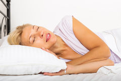 Mature female in pajamas sleeping Stock Image