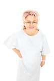 Mature female patient in gown looking at camera Royalty Free Stock Photography