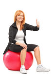 Mature female sitting on a pilates ball Stock Photo