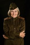 Mature female soldier. On a black background royalty free stock photo