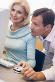 Mature female student learning computer skills.  Royalty Free Stock Photos