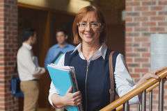 Mature female student posing in corridor Royalty Free Stock Images