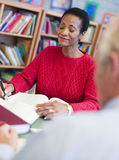 Mature female student studying in library Royalty Free Stock Photo