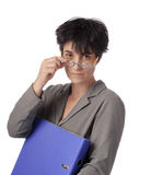 Mature female teacher looking over her glasses Stock Photo