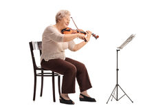 Mature female violinist playing a violin Royalty Free Stock Photos