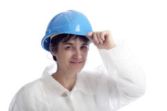 Mature female worker with blue helmet Royalty Free Stock Images