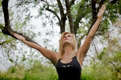 Mature Female Yogi Extends Arms Upward Royalty Free Stock Image