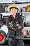 Mature Firefighter Standing Arms Crossed Against Royalty Free Stock Image