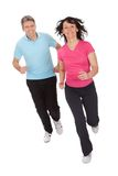 Mature fitness couple running Royalty Free Stock Photo