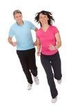 Mature fitness couple running royalty free stock photo