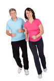 Mature fitness couple running Stock Images