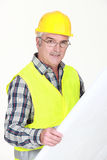Mature foreman checking plans. Royalty Free Stock Photos