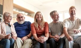 Free Mature Friends Sitting On The Couch In A Quiet Evening . Royalty Free Stock Photo - 185933005