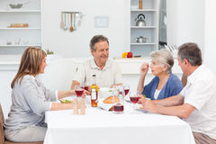 Mature friends taking lunch together Stock Images