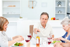 Mature friends taking lunch together Royalty Free Stock Photography