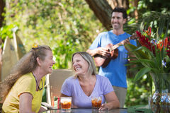 Mature Friends with Ukelele Player Stock Photos