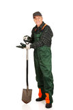 Mature gardener with a spade Royalty Free Stock Image