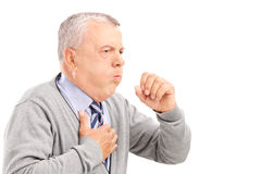 A mature gentleman coughing because of pulmonary disease. Isolated on white background Stock Images