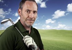 Mature golf player. Portrait of a golf player Royalty Free Stock Photos