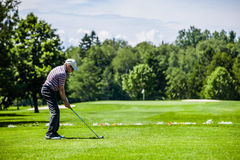 Mature Golfer on a Golf Course Stock Image
