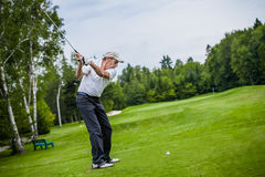 Mature Golfer on a Golf Course. Taking a Swing on the Start Stock Image