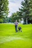 Mature Golfer on a Golf Course Stock Photos