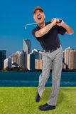 Mature golfer swinging his golf club Royalty Free Stock Images