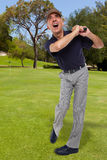 Mature golfer swinging his golf club Royalty Free Stock Photo