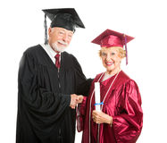 Mature Graduate Receives Diploma Royalty Free Stock Image
