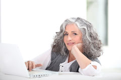 Mature grey-haired lady Stock Photography
